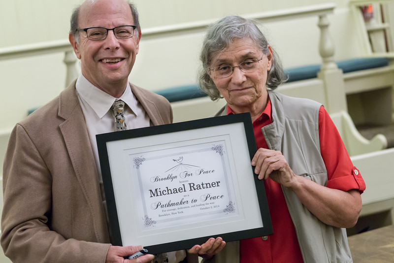 Michael Ratner, President Emeritus of the Center for Constitutional Rights (CCR), receiving Brooklyn For Peace's <i>Pathmakers To Peace</i> award from BFP Chair, Dr. Charlotte Phillips.