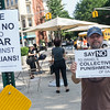 At the Vigil For An End To Israel's War Against Gaza. Gary holds a sign to inform passing motorists.