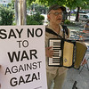 Paul Stein, an activist-accordionist played songs of peace for the vigilers.