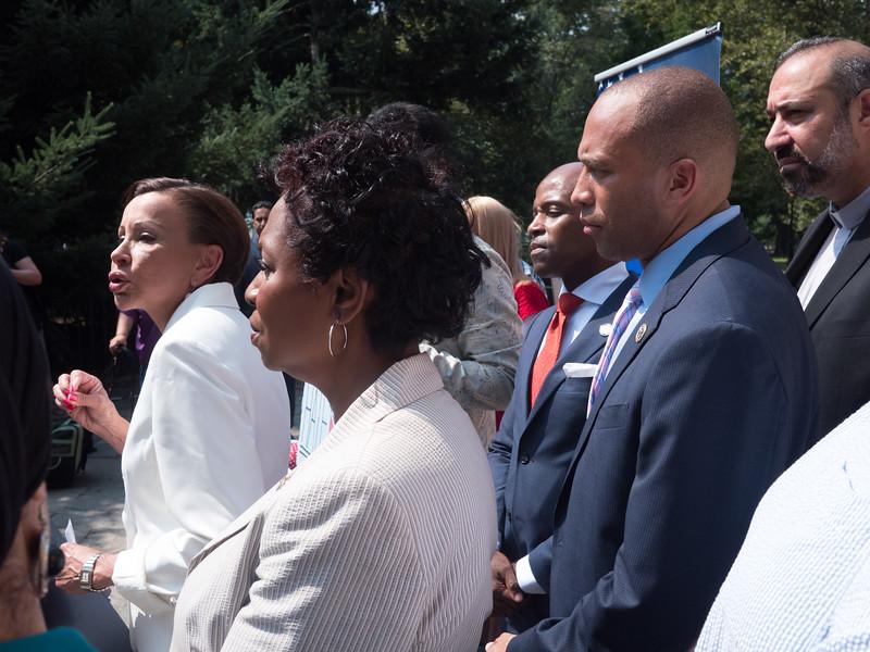 Rep. Nydia Velazquez addresses the press alongside Reps. Clarke and Jeffries.