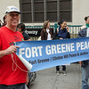 Mark Dunlea and Ed Goldman hold the Fort Greene Peace banner at the FUREE march for jobs and affordable housing.