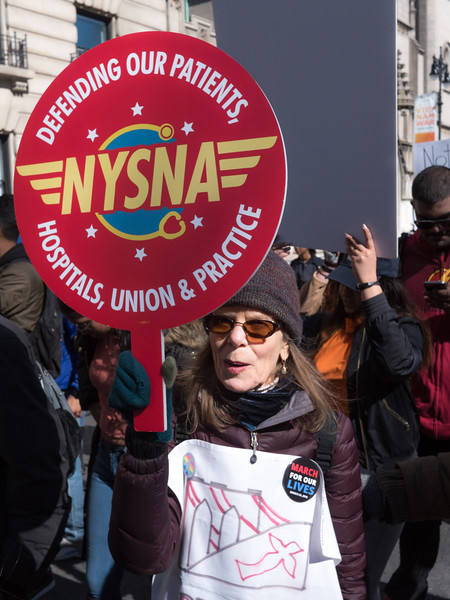 Jackie holds a NYS Nurses Association banner. Who knows better than nurses the  horrors of gun violence?