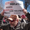 Sam carries a message on top of his head: war abroad begets guns and violence at home.