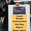 Stanley Heller of the ​Coalition to End the US-Saudi Alliance and one of the organizers of today's protest at Wall Street, holds a photo showing the devastation caused by Saudi bombs (made in  and sold by the U.S. to  the Saudi despots. Nothing has been spared from the Scriminal and ghastly audi bombs: hospitals, stadiums, schools, markets and other public gathering places.