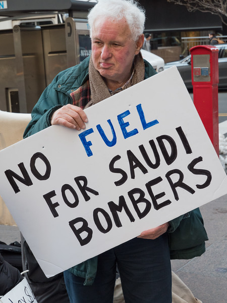 This sign protets U.S. aid to the Saudi bombing campaign. U.S. planes refuel Saudi jets on bombing runs on Yemen. Without such aid, the war could not go on.