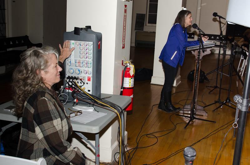 Sound technician Shawn Walsh monitors Amy Goodman's set up. Thanks!