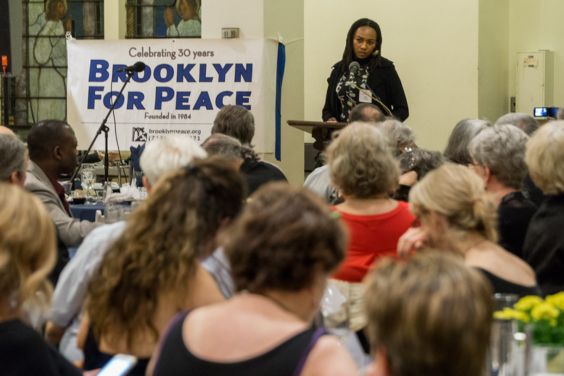 Honoree Opal Tometi and part of the audience that crowdd into Plymouth Church for the Pathmakers To Peace gala dinner.