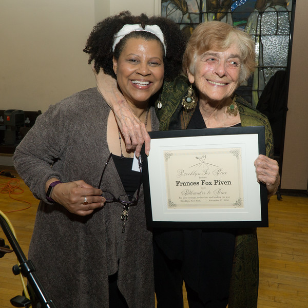 Veronica Nunn, Vice Chair of Brooklyn For Peace and the evening's moderator, presents the Pathmaker To Peace award to Frances Fox Piven.