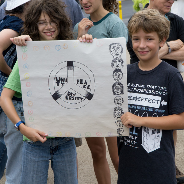 These kids made this signs and carried it proudly.