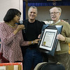 UUP Treasurer, Rowena Blackman-Stroud, presents a plaque of appreciation to BFP members, Matthew Weinstein and Bruce Altschuler. The union appreciated our organization's support over the years as part of the neighborhood coalition fighting cutbacks and layoffs at Downstate Medical Center.