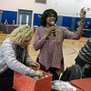 BFPer Stacey Weinstein, helps draw a raffle ticket at the UUP holiday party.