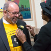 Chris Owens of the Central Brooklyn Martin Luther King Commission, receives a carnation from a colleague.