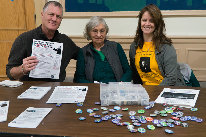 The Brooklyn For Peace table at the MLK birthday celebration. Left to right: Matthew Weinstein, BFP Chair Dr. Charlotte Phillips and BFP Program Director Melissa Corbett. The table was very popular. Matt holds up a flyer that was distributed and free buttons were given out.