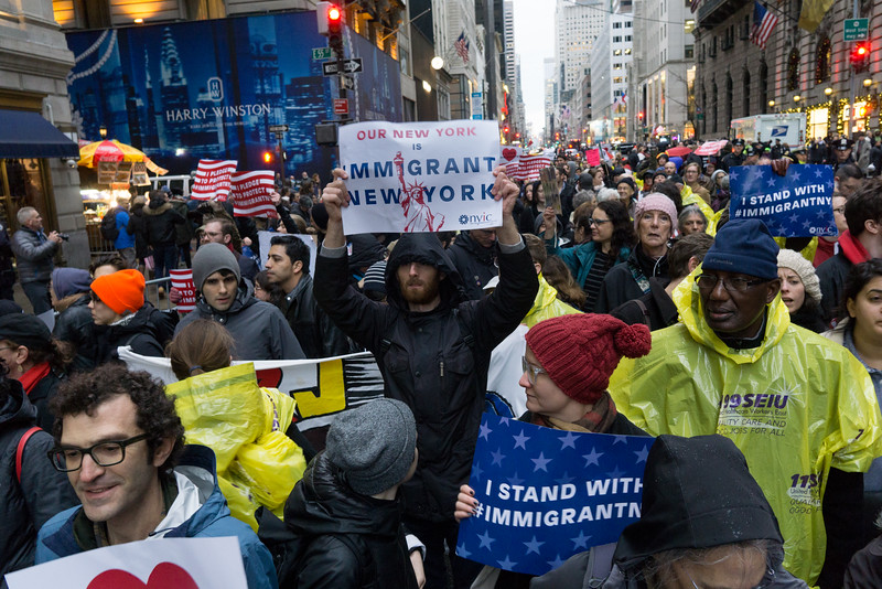 The street in front of Trump's building was swelled by the ranks of immigrants and their friends.