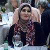 One of the evening's honorees, Linda Sarsour, appreciating the speakers.