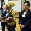 Eisenberg asked for recognition of two leaders from the Domestic Workers United, a union of women workers in the home care industry including domestic workers, housekeepers and child care workers. Here, as Eisenberg looks on,  Christine Lewis, Secretary of Cultural Outreach, on the left, addresses the event  and Patrica Francois, DWU Chair, looks on.