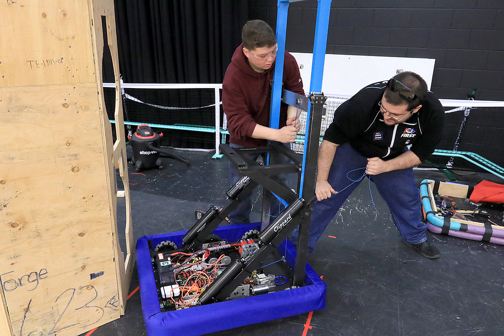 """. The kids in the Boys and Girls Club of Fitchburg and Leominster\'s robotics club, called \""""Terrorbots\"""", where working hard on their new robot on Tuesday  trying to finish it for their upcoming competition. Working on the robot is the Robotics Program Coordinator Jacob Janssens and Jalen Leider, 15, who is a sophomore at Montachusett Regional Vocational Technical School in Fitchburg. SENTINEL & ENTERPRISE/JOHN LOVE"""