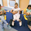Douglas Siqueira a music teacher from Indian Hill Music taught a ukulele class at the Boys and Girls club on Wednesday, July 24, 2019. Suhaly Rosado, 9 from Fitchburg, Jennie-Lynn Abdurraheen, 11, from Fitchburg and Camila Santiago, 8, from Fitchburg try and learn to play Twinkle Twinkle Little Star during the workshop. SENTINEL & ENTERPRISE/JOHN LOVE