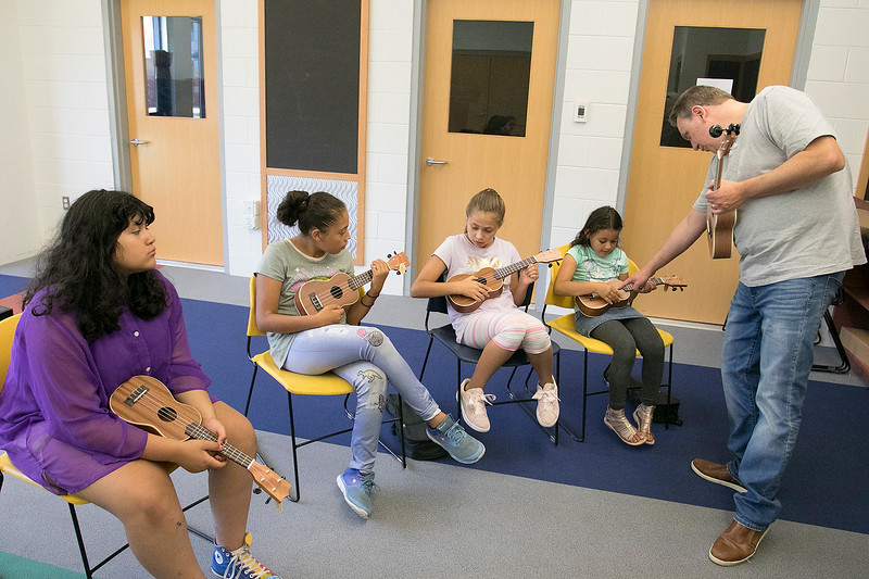 Douglas Siqueira a music teacher from Indian Hill Music taught a ukulele class at the Boys and Girls club on Wednesday, July 24, 2019. Siqueira shows the kids which string to strum as he teaches them to play Twinkle Twinkle Little Star. SENTINEL & ENTERPRISE/JOHN LOVE