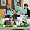 """Students at the Boys and Girls Club of Fitchburg and Leominster built two futuristic cities so they could compete in the New England competition """"Future City."""" Future City is a project-based learning program where students imagine, research, design, and build the cities of the future. They had two team from the club compete in the competition. This group called their city """"Future Town."""" From left is Amya Burgos, 9, Amelia Carboni, 10, Anabelle Bien-Aime, 12, and Nicholas Carboni, 13. They are holding the three awards that their city won at the competition. SENTINEL & ENTERPRISE/JOHN LOVE"""