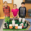 """Students at the Boys and Girls Club of Fitchburg and Leominster built two futuristic cities so they could compete in the New England competition """"Future City."""" Future City is a project-based learning program where students imagine, research, design, and build the cities of the future. They had two team from the club compete in the competition. This group called their city """"Moon City."""" From left is Desmond Batch, 11, Ava Bettencourt and Aaron Traingue. SENTINEL & ENTERPRISE/JOHN LOVE"""
