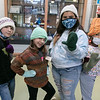 Boys and Girls Club of Fitchburg Leominster members Tatum Chalifoux, 9, Isabelle Chalifoux, 8, Elsa Reyes, 10, and Ann Kelisha, 6, show off some of the items that Warmer Winter donated to the club recently. They are wearing hats, mittens and a pull over made by Warmer Winters. SENTINEL & ENTERPPRISE/JOHN LOVE<br /> <br /> Warmer Winters is a 501 c3 that gives yarn free to all its volunteers.  The monthly yarn budget is about $500. That money comes from caring people like the employees of D'Ambrosio Eye Care.  Because Warmer Winters is all volunteer, all money donated goes to warming neighbors in need.  The donation made by the employees of D'Ambrosio Eye Care to the Boys & Girls Club of Fitchburg Leominster and Gardner did just that!  As little as $25 provides enough yarn to warm the hands of six little children. With $50 volunteers can craft heavy, warm sweaters for 3 children. Whatever amount donated makes 3 children feel really good! The employees of D'Ambrosio Eye Care feel really good knowing that their donation bought yarn for the warmth to be given to many Fitchburg Leominster and  Gardner children.