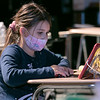 Emily Viola, 6, from Westminster watches a virtual classroom through the Zoom platform. The Boys and Girls Club has set up a program at Montachusett Regional Vocational Technical School's Performing Arts Center to help students with their virtual learning classrooms. SENTINEL & ENTERPRISE/JOHN LOVE