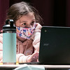 Kennedy Lord, 9, from Fitchburg watches a virtual classroom through the Zoom platform. The Boys and Girls Club has set up a program at Montachusett Regional Vocational Technical School's Performing Arts Center to help students with their virtual learning classrooms. SENTINEL & ENTERPRISE/JOHN LOVE