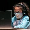 Ava Babb, 9, of Gardner watches a virtual classroom through the Zoom platform. The Boys and Girls Club has set up a program at Montachusett Regional Vocational Technical School's Performing Arts Center to help students with their virtual learning classrooms. SENTINEL & ENTERPRISE/JOHN LOVE