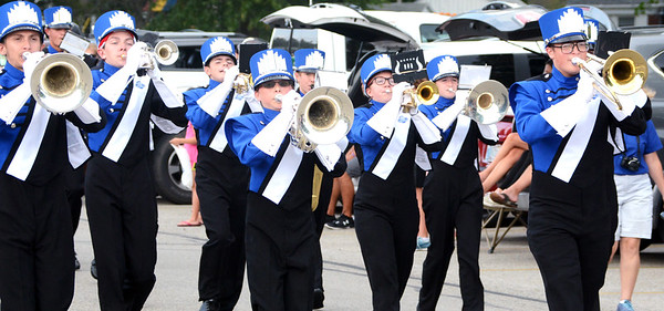 Will Fehlinger | The Herald-Tribune The horns section toots out a tune as the Batesville High School marching band participates in the homecoming parade.