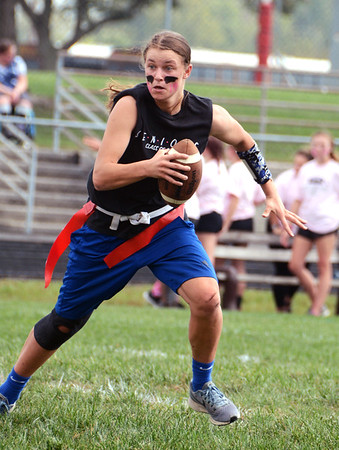 Will Fehlinger   The Herald-Tribune<br /> Quarterback Stephanie Nobbe led the senior girls against the juniors in this year's powder puff football contest.