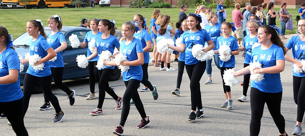 Will Fehlinger   The Herald-Tribune<br /> The Batesville Middle School dance team performs for parade specators during homecoming night Friday.