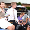 Will Fehlinger | The Herald-Tribune<br /> Junior Madison Chambers, escorted by Jacob Nobbe, sends a handful of candy to the street during Batesville's homecoming parade Sept. 21.