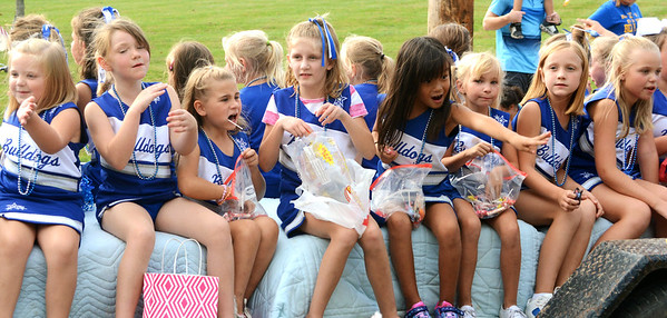 Will Fehlinger | The Herald-Tribune Youth football cheerleaders had fun passing out candy during the homecoming parade Friday.
