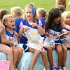 Will Fehlinger | The Herald-Tribune<br /> Youth football cheerleaders had fun passing out candy during the homecoming parade Friday.