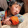 Boy watching the dancers, Ura valley tsechu festival, Bumthang