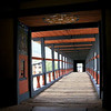 Paro Bridge. Below the dzong, this traditional covered bridge called Nyamai Zam spans the Paro Chhu River and it is a reconstruction of the original bridge which was washed away in a flood in 1969.