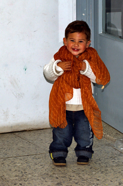 Liam in the Hoyo congregation after church... (he was playing with Merly's scarf.)