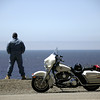 biker man on the coast, with Harley Davidson motorcycle, California, USA