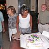 JIMMY PRITCHETT, MAGGIE, DAVENIA & HER HUSBAND AL & GLORIA GET READY TO CUT THE BIRTHDAY CAKE.