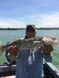 BJ showing off a 21 inch walleye from Moses Lake.