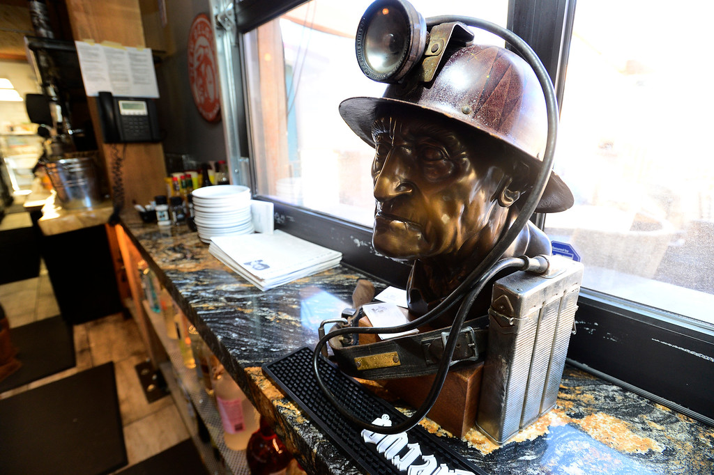 . A bust of Black Diamond owner Rick Ross\' grandfather, who worked in the Black Diamond mine, sits behind the bar at the restaurant of the same name in Lafayette on Tuesday March 6, 2018. Paul Aiken Staff Photographer March 6 2018