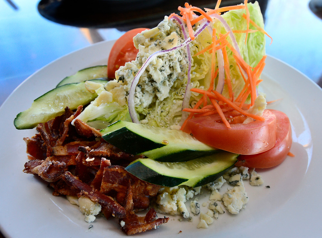 """. The \""""Hecla #1\""""at the Black Diamond restaurant in Lafayette on Tuesday March 6, 2018. A crisp iceberg wedge with bacon, Gorgonzola, onions, cucumbers and tomatoes.  Paul Aiken Staff Photographer March 6 2018"""