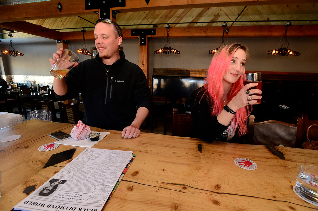 . Carl Hackney and Bethany Johnson enjoy a drink at the bar at the Black Diamond restaurant in Lafayette on Tuesday March 6, 2018. Paul Aiken Staff Photographer March 6 2018