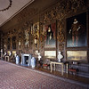 The four paintings by Turner restored to the panelling, looking North in The Carved Room at Petworth House, West Sussex