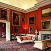 The Red Room of Petworth House, which contains paintings by Turner,  Van Dyck, and Titian
