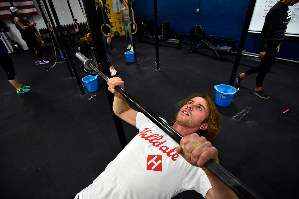 . BOULDER, CO. NOVEMBER 14, 2018 Jerod Barker works in the Australian Pull-ups area of the BLDR30 workout at Boulder Athletics in Boulder on Wednesday.  For more photos go to dailycamera.com  (Photo by Paul Aiken/Staff Photographer)