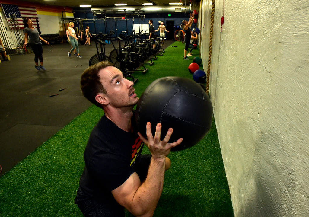. BOULDER, CO. NOVEMBER 14, 2018 Park Roberts works in the Wall Ball section of the BLDR30 workout at Boulder Athletics in Boulder on Wednesday.  For more photos go to dailycamera.com  (Photo by Paul Aiken/Staff Photographer)