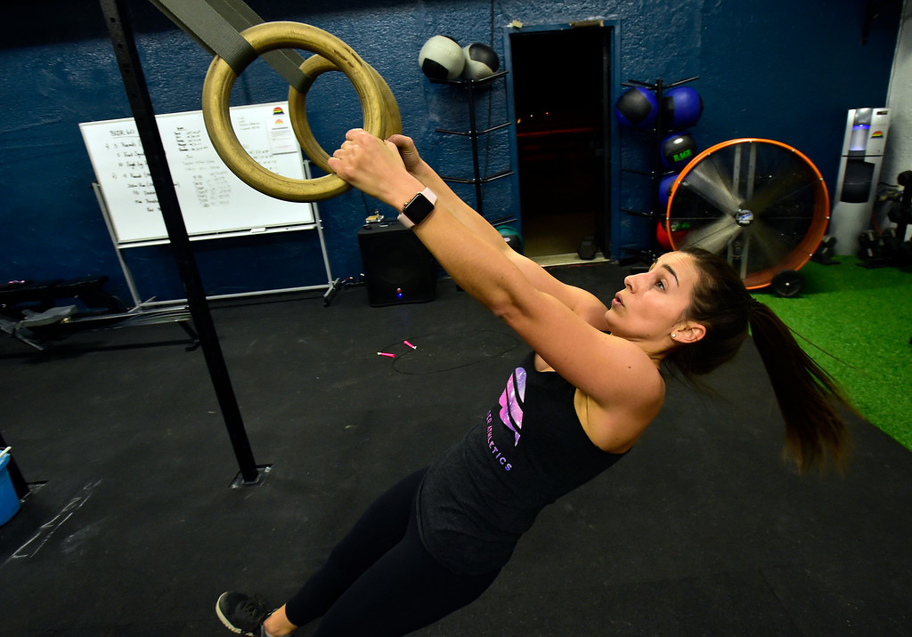 . BOULDER, CO. NOVEMBER 14, 2018 Kelsi Roberts works on the Ring Rows in the BLDR30 workout at Boulder Athletics in Boulder on Wednesday.  For more photos go to dailycamera.com  (Photo by Paul Aiken/Staff Photographer)