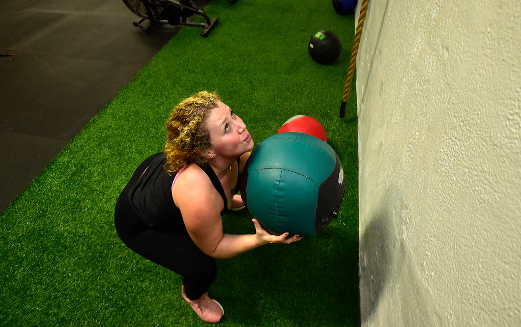. BOULDER, CO. NOVEMBER 14, 2018 Shira Feinstein works in the Wall Ball portion of the BLDR30 workout at Boulder Athletics in Boulder on Wednesday.  For more photos go to dailycamera.com  (Photo by Paul Aiken/Staff Photographer)